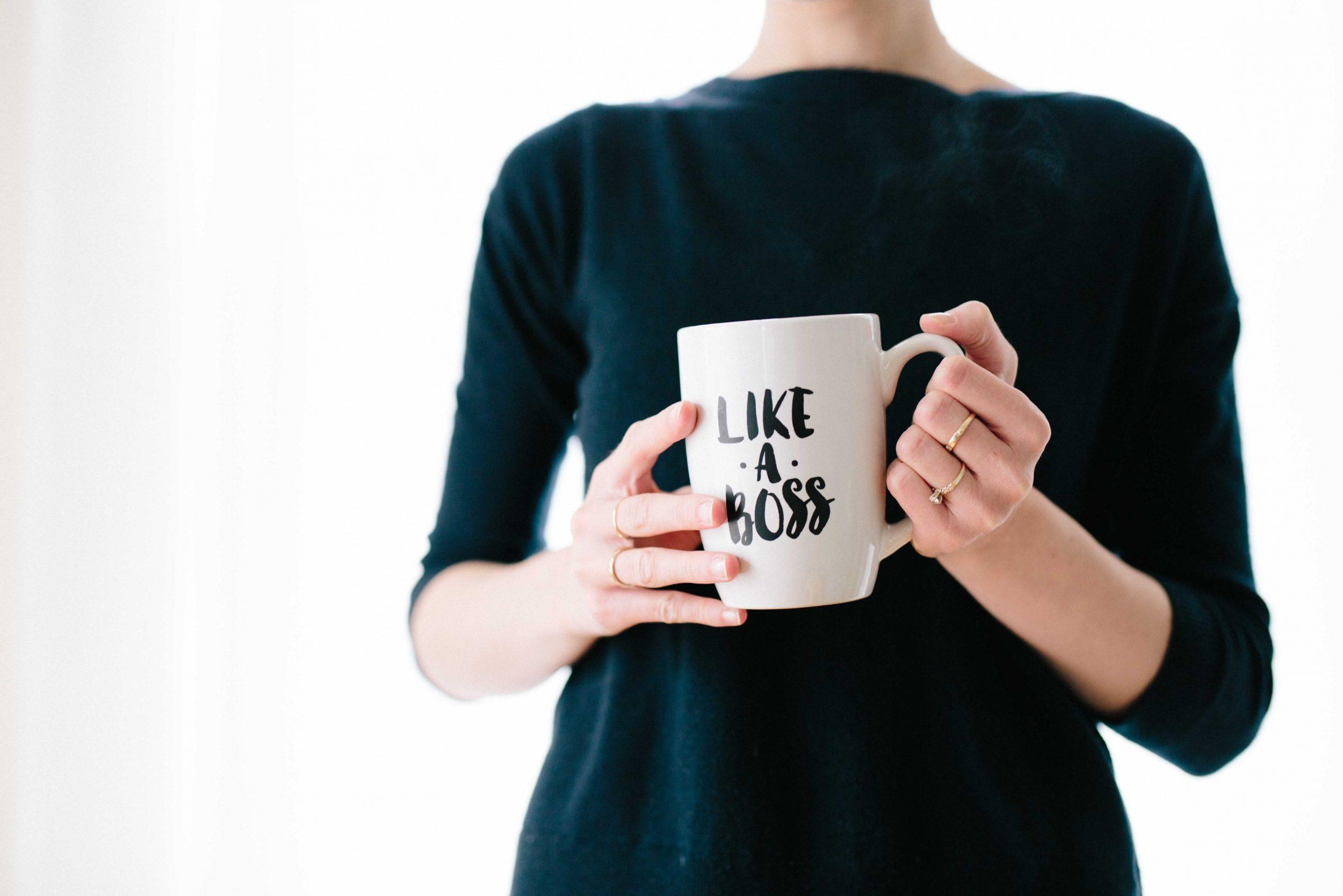 Woman with Boss coffee mug